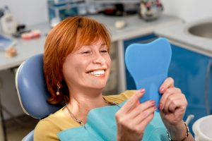 Elder Woman Smiling in Dental Office