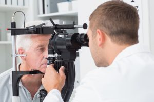 Older man getting and eye exam