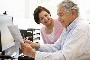 Couple reviewing and comparing medicare plans online