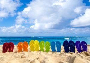 Colorful flip flops in Hawaiian sand