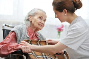 Nurse helping an old lady , part of end of life care