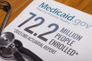 Sign with information about Medicaid Expansion on a desk
