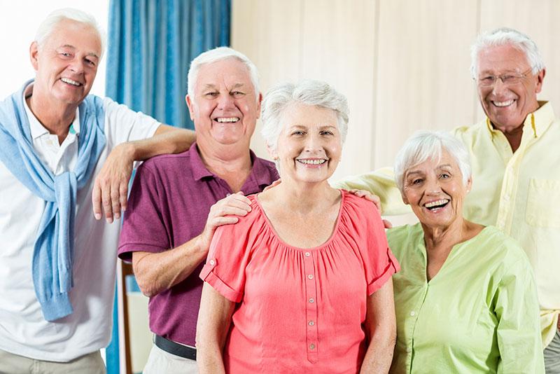 Senior citizens smiling for the camera