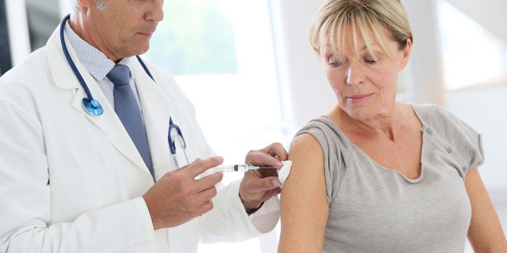 Doctor Injecting Shingles Vaccine