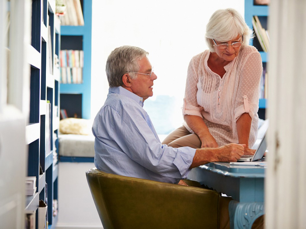 Senior Couple at home discussing retirement options & Medigap issues