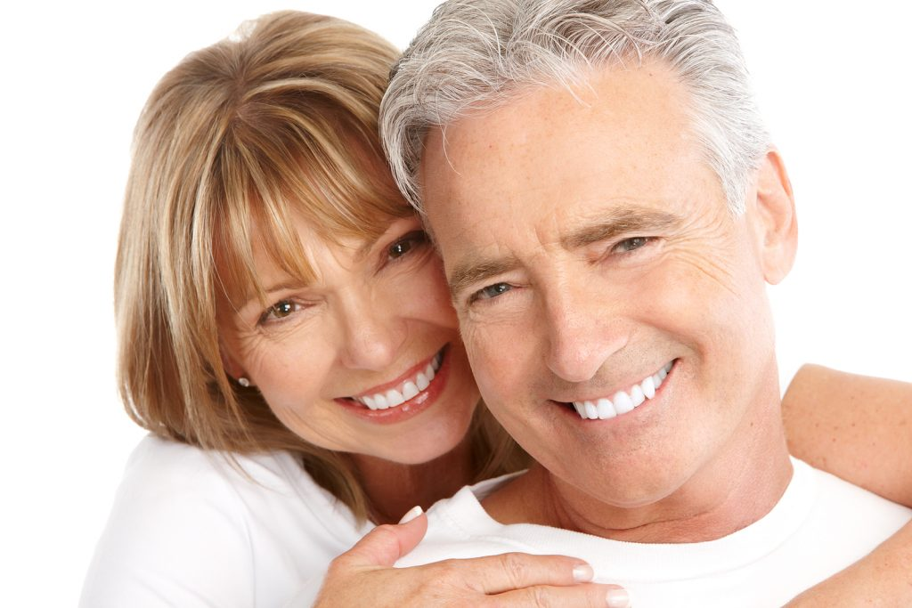 Happy seniors couple in love. Healthy teeth after good oral care . Isolated over white background