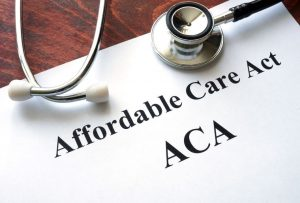 Affordable Care Act written in a Paper