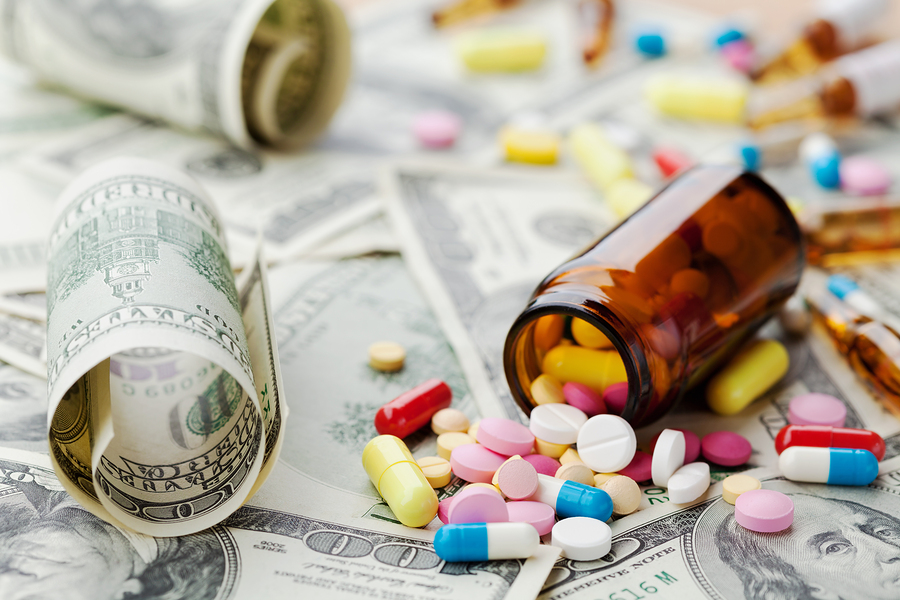 Pile of prescription drugs and medicine pills on dollar money,