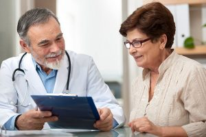Doctor talking to his patient about preventive screenings