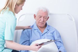 Doctor talking to patient about end of life coverage