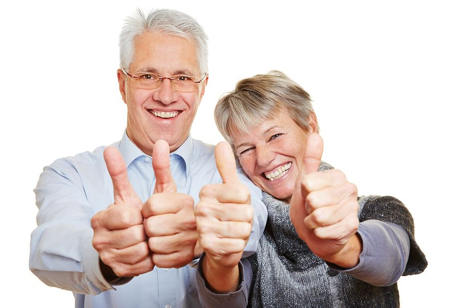 Happy Senior couple showing thumbs up because SSN is removed fromved from their Medicare id cards