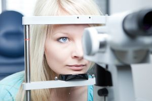 Eye care : Checkup of a young woman's eyes
