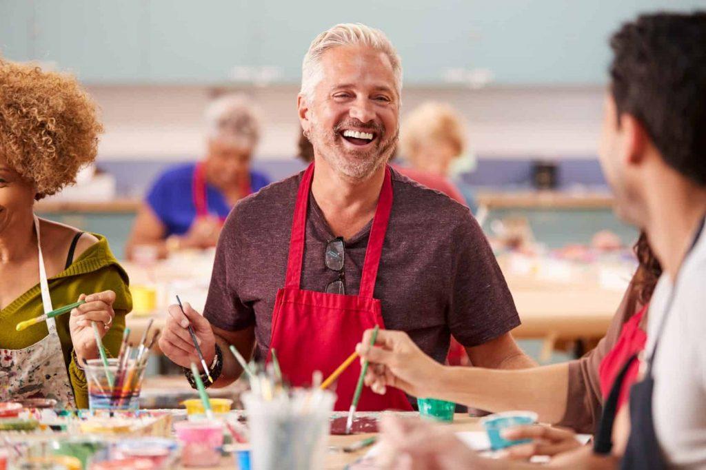 Seniors enjoying an art class at an active adult community