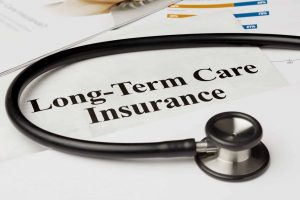 Long term care insurance paper and stethoscope